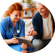 a nurse and an old man looking at a tablet